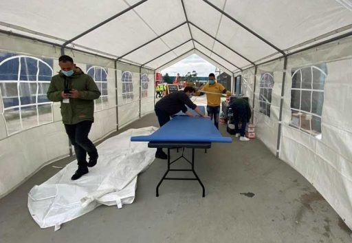 People prepare catering tent